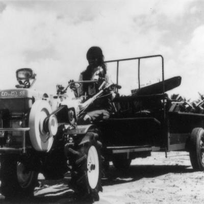 Lady Farmer Driving Tractor